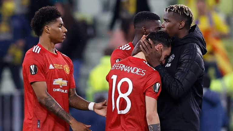 Manchester United players react after losing the Europa League fiinal on penalties