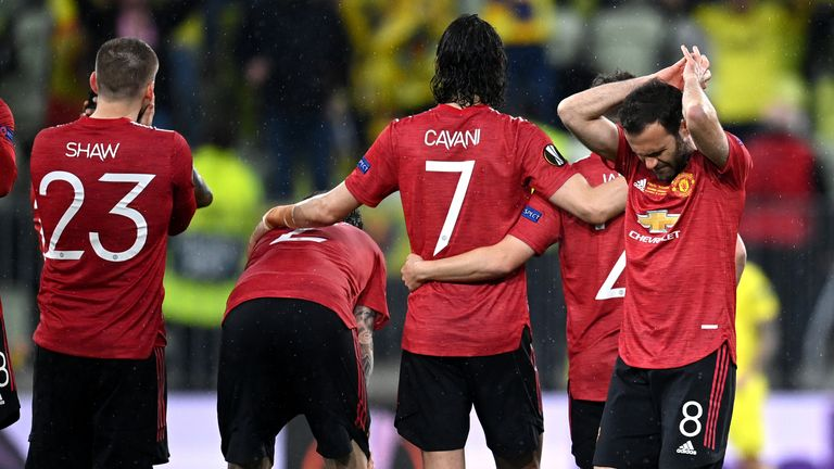 Manchester United players react during the penalty shootout in the Europa League final