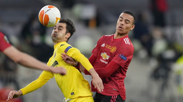 Villareal's Manu Trigueros, left, challenges for the ball with Manchester United forward Mason Greenwood