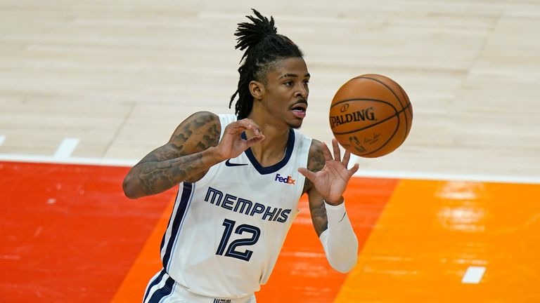 Memphis Grizzlies guard Ja Morant brings the ball up court during Game 2 against the Utah Jazz