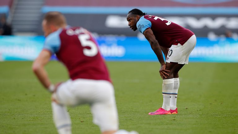 Michail Antonio looks dejected at the final whistle