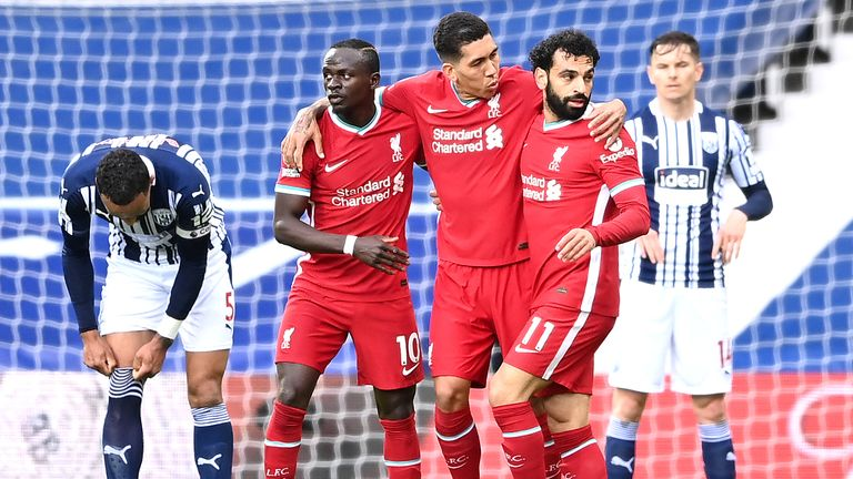 Mohamed Salah is congratulated by teammates Sadio Mane and Roberto Firmino