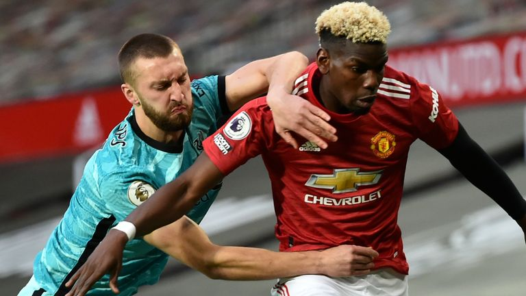 Nat Phillips and Paul Pogba battle at Old Trafford