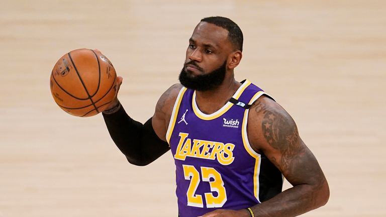 Los Angeles Lakers forward LeBron James dribbles during the first half of an NBA basketball game against the Sacramento Kings Friday, April 30, 2021, in Los Angeles.