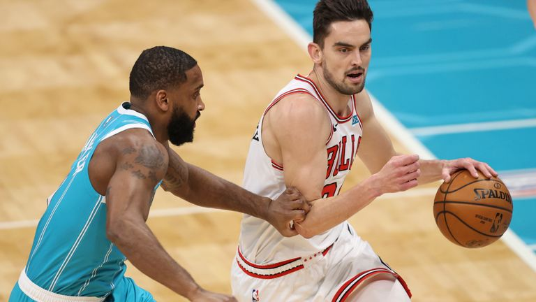 Chicago Bulls guard Tomas Satoransky, right, drives as Charlotte Hornets guard Brad Wanamaker defends during the second half of an NBA basketball game in Charlotte, N.C., Thursday, May 6, 2021. Chicago won 120-99. (AP Photo/Nell Redmond)