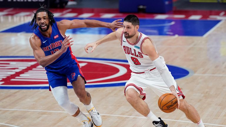 Chicago Bulls center Nikola Vucevic (9) drives as Detroit Pistons center Jahlil Okafor defends during the second half of an NBA basketball game, Sunday, May 9, 2021, in Detroit. (AP Photo/Carlos Osorio)