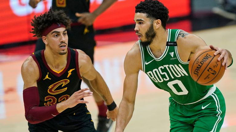 Boston Celtics' Jayson Tatum (0) drives against Cleveland Cavaliers' Brodric Thomas (33) in the first half of an NBA basketball game, Wednesday, May 12, 2021, in Cleveland.