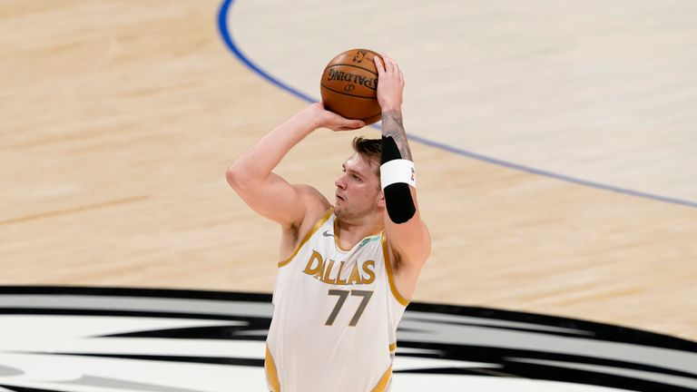 Dallas Mavericks' Luka Doncic attempts a three-point basket during the first half of an NBA basketball game against the Brooklyn Nets in Dallas, Thursday, May 6, 2021. (AP Photo/Tony Gutierrez)
