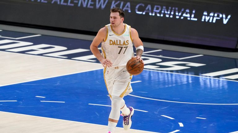 Dallas Mavericks' Luka Doncic advances the ball up court during an NBA basketball game against the Brooklyn Nets in Dallas, Thursday, May 6, 2021. (AP Photo/Tony Gutierrez)