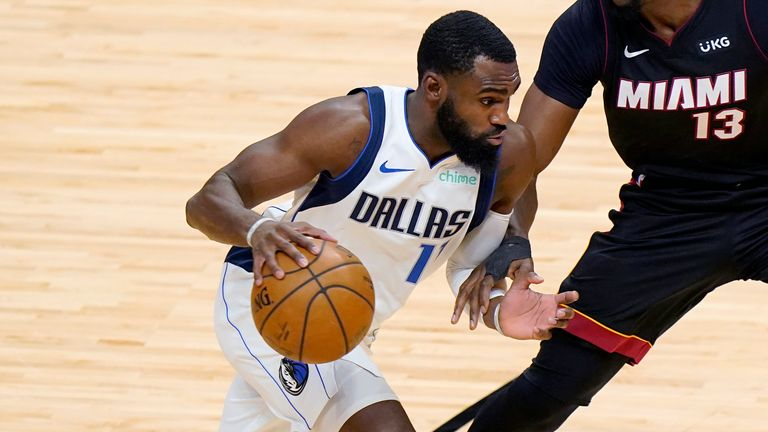 Dallas Mavericks forward Tim Hardaway Jr. (11) drives up against Miami Heat center Bam Adebayo (13) during the first half of an NBA basketball game, Tuesday, May 4, 2021, in Miami.