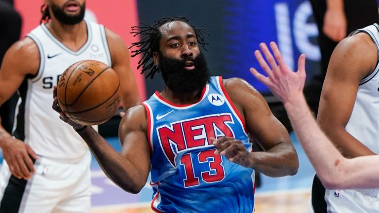 Brooklyn Nets' James Harden (13) looks to pass away from San Antonio Spurs' Rudy Gay (22) during the second half of an NBA basketball game Wednesday, May 12, 2021, in New York.