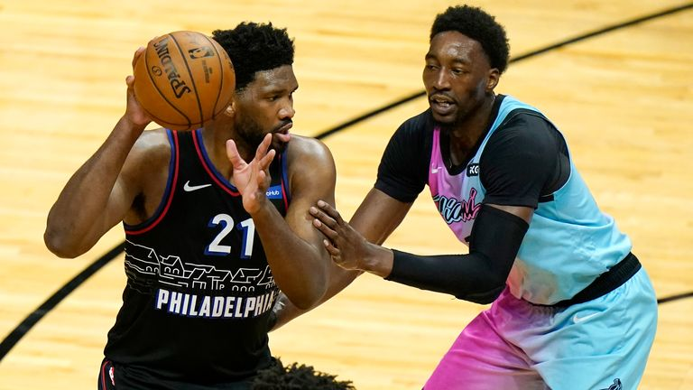 Miami Heat center Bam Adebayo, right, defends Philadelphia 76ers center Joel Embiid (21) during the first half of an NBA basketball game, Thursday, May 13, 2021, in Miami.