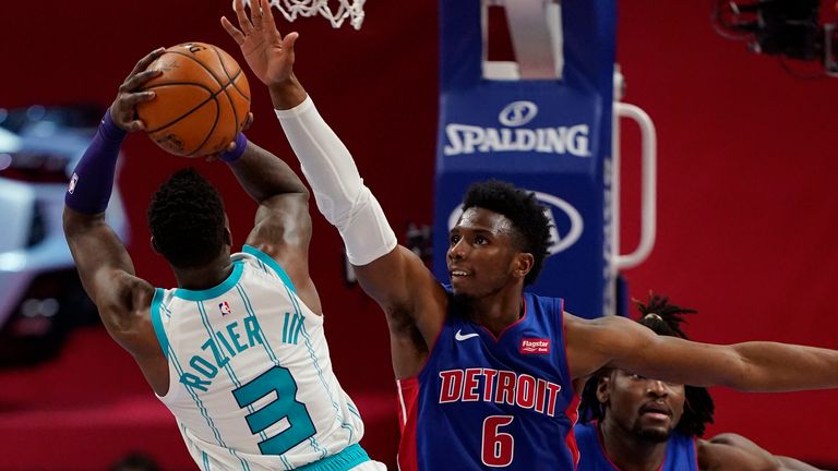 Charlotte Hornets guard Terry Rozier (3) shoots over the defense of Detroit Pistons guard Hamidou Diallo (6) during the second half of an NBA basketball game, Tuesday, May 4, 2021, in Detroit.