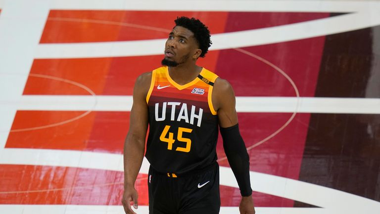Utah Jazz guard Donovan Mitchell (45) looks at the scoreboard during the first half of Game 2 of their NBA basketball first-round playoff series against the Memphis Grizzlies Wednesday, May 26, 2021, in Salt Lake City. (AP Photo/Rick Bowmer)