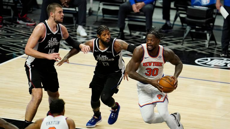 New York Knicks forward Julius Randle (30) drives to the basket against the Los Angeles Clippers during the second half of an NBA basketball game Sunday, May 9, 2021, in Los Angeles. (AP Photo/Marcio Jose Sanchez)