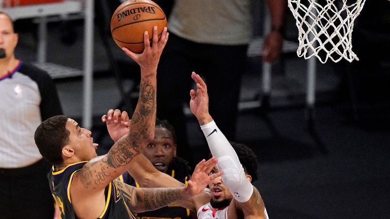 Los Angeles Lakers forward Kyle Kuzma, left, shoots and scores as Houston Rockets forward Kenyon Martin Jr., right, defends in the closing seconds of the second half of an NBA basketball game Wednesday, May 12, 2021, in Los Angeles.