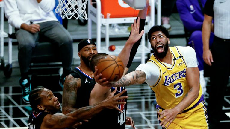 Los Angeles Lakers' Anthony Davis (3) shoots while defended by Los Angeles Clippers' Kawhi Leonard, left, during the first half of an NBA basketball game Thursday, May 6, 2021, in Los Angeles. (AP Photo/Ringo H.W. Chiu)