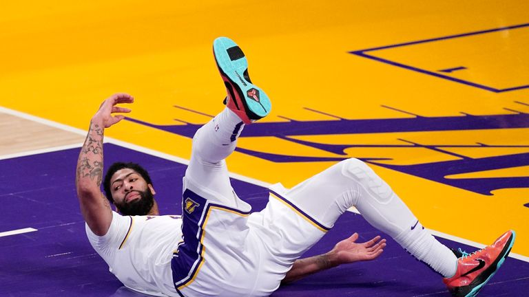 Los Angeles Lakers forward Anthony Davis falls during the second half of an NBA basketball game against the Toronto Raptors Sunday, May 2, 2021, in Los Angeles. (AP Photo/Mark J. Terrill)