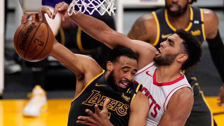 Los Angeles Lakers guard Talen Horton-Tucker, left, grabs a rebound away from Houston Rockets forward Anthony Lamb during the second half of an NBA basketball game Wednesday, May 12, 2021, in Los Angeles.
