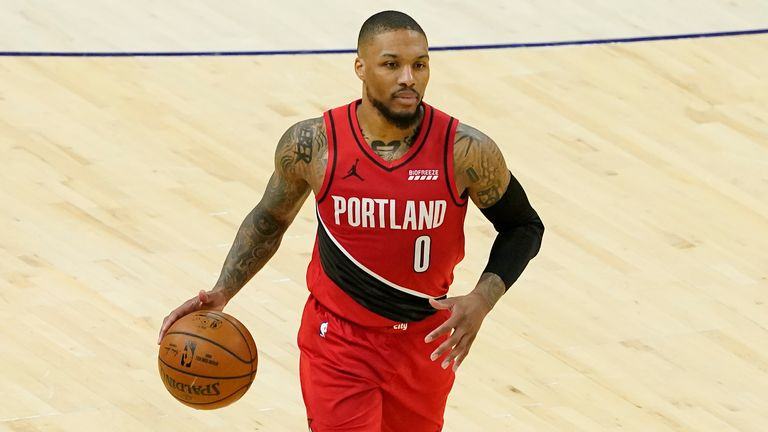 Portland Trail Blazers guard Damian Lillard (0) against the Phoenix Suns during the second half of an NBA basketball game, Thursday, May 13, 2021, in Phoenix.