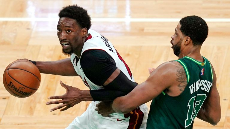 Miami Heat center Bam Adebayo, left, drives to the basket past Boston Celtics center Tristan Thompson (13) during the second half of an NBA basketball game, Tuesday, May 11, 2021, in Boston. (AP Photo/Charles Krupa)