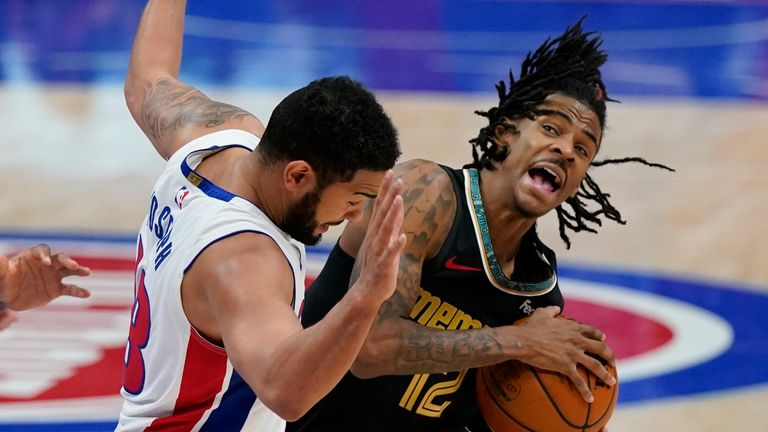 Memphis Grizzlies guard Ja Morant (12) is fouled by Detroit Pistons guard Cory Joseph (18) during the second half of an NBA basketball game, Thursday, May 6, 2021, in Detroit. (AP Photo/Carlos Osorio)