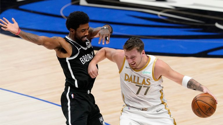 Brooklyn Nets' Kyrie Irving (11) defends as Dallas Mavericks guard Luka Doncic (77) advances the ball upcourt in the first half of an NBA basketball game in Dallas, Thursday, May 6, 2021. (AP Photo/Tony Gutierrez)