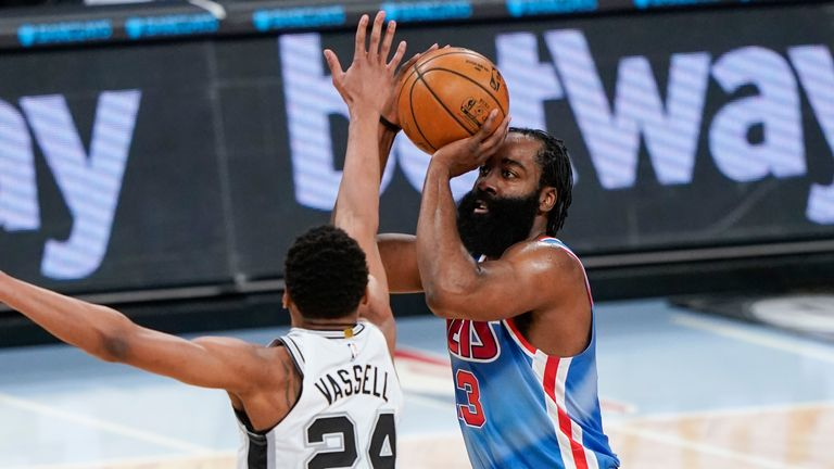 Brooklyn Nets' James Harden, right, shoots over San Antonio Spurs' Devin Vassell during the second half of an NBA basketball game Wednesday, May 12, 2021, in New York.