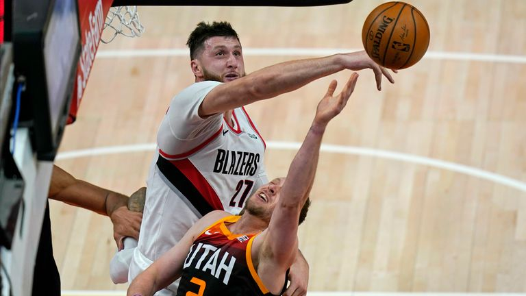 Utah Jazz guard Joe Ingles (2) has his shot blocked by Portland Trail Blazers center Jusuf Nurkic (27) during the first half of an NBA basketball game Wednesday, May 12, 2021, in Salt Lake City.