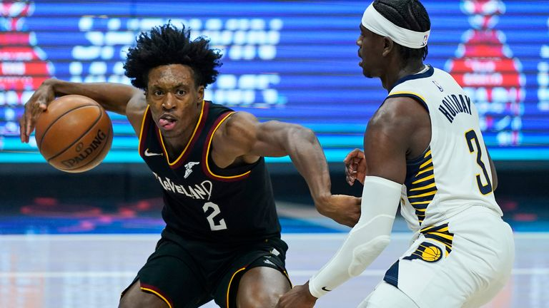 Cleveland Cavaliers' Collin Sexton (2) drives against Indiana Pacers' Aaron Holiday (3) in the first half of an NBA basketball game, Monday, May 10, 2021, in Cleveland.