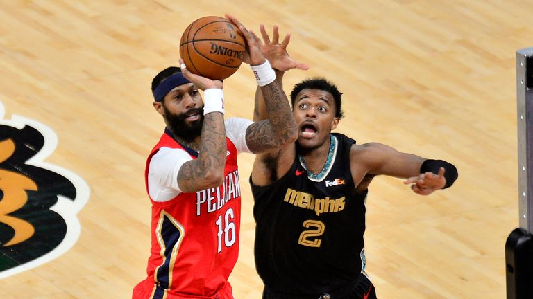 New Orleans Pelicans forward James Johnson (16) shoots against Memphis Grizzlies center Xavier Tillman (2) in the second half of an NBA basketball game Monday, May 10, 2021, in Memphis, Tenn.