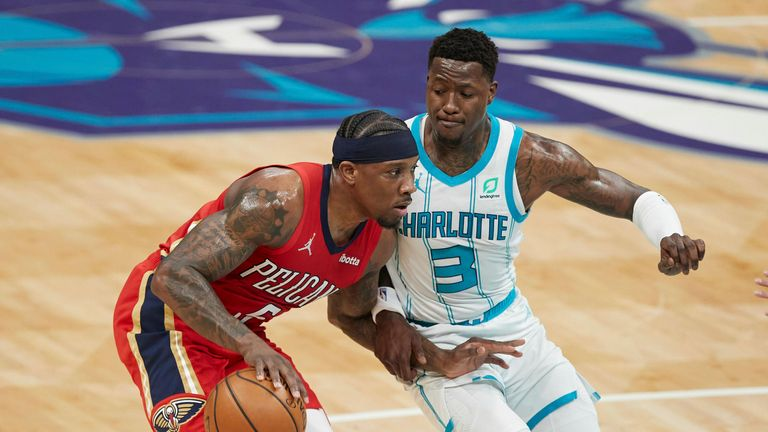 New Orleans Pelicans guard Eric Bledsoe (5) drives past Charlotte Hornets guard Terry Rozier (3) during the first half of an NBA basketball game Sunday, May 9, 2021, in Charlotte, N.C. (AP Photo/Brian Westerholt)
