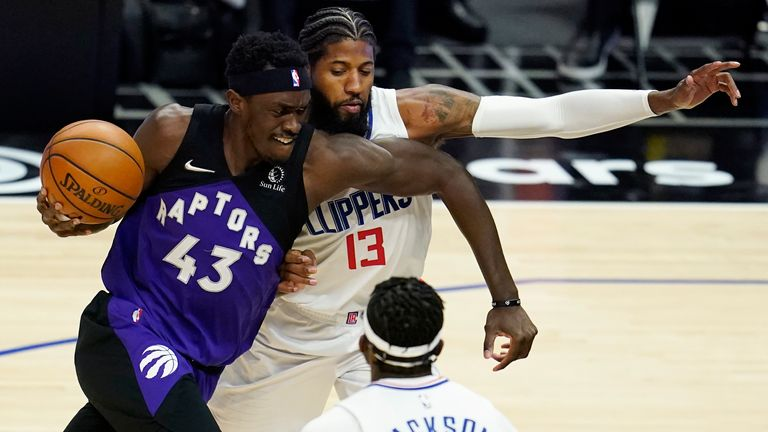 Toronto Raptors forward Pascal Siakam (43) is defended by Los Angeles Clippers guard Paul George (13) during the first half of an NBA basketball game Tuesday, May 4, 2021, in Los Angeles. (