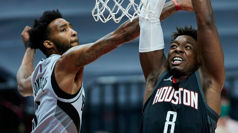 Houston Rockets forward Jae'Sean Tate, right, shoots over Portland Trail Blazers forward Derrick Jones Jr., during the first half of an NBA basketball game in Portland, Ore., Monday, May 10, 2021.