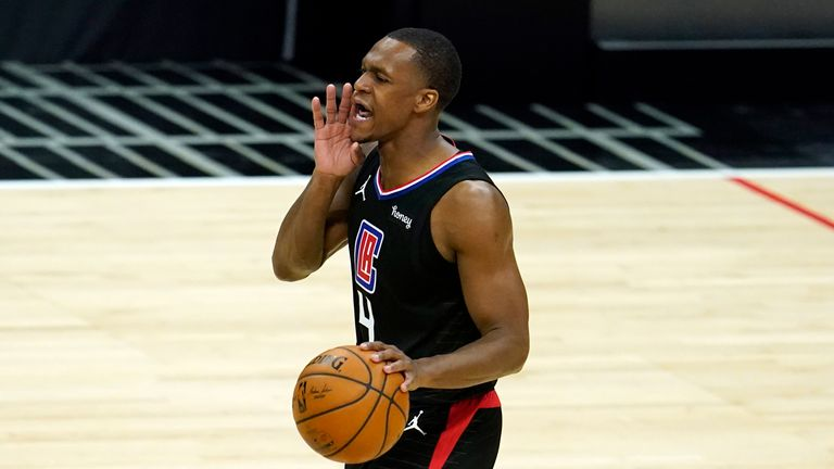 Los Angeles Clippers guard Rajon Rondo dribbles during an NBA basketball game against the Phoenix Suns Thursday, April 8, 2021, in Los Angeles. (AP Photo/Marcio Jose Sanchez)