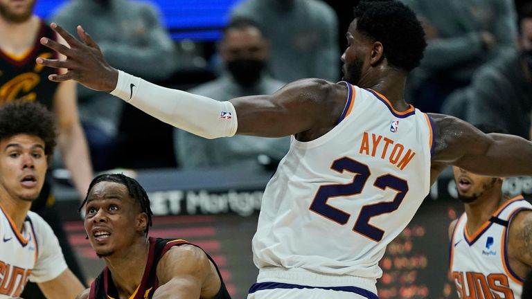 Cleveland Cavaliers' Isaac Okoro (35) drives to the basket against Phoenix Suns' Deandre Ayton (22) in the second half of an NBA basketball game, Tuesday, May 4, 2021, in Cleveland.