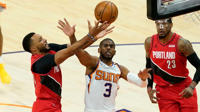 Portland Trail Blazers forward Norman Powell shoots as Phoenix Suns guard Chris Paul (3) defends during the second half of an NBA basketball game, Thursday, May 13, 2021, in Phoenix.