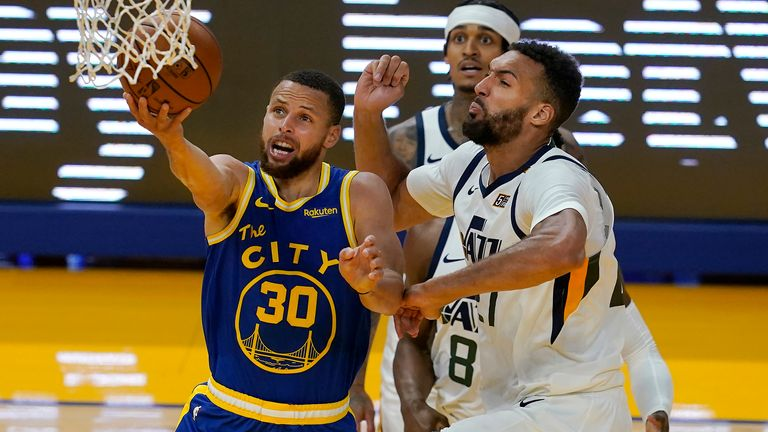 Golden State Warriors guard Stephen Curry (30) shoots against Utah Jazz center Rudy Gobert during the second half of an NBA basketball game in San Francisco, Monday, May 10, 2021.