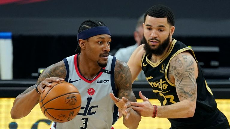 Washington Wizards guard Bradley Beal (3) drives around Toronto Raptors guard Fred VanVleet (23) during the first half of an NBA basketball game Thursday, May 6, 2021, in Tampa, Fla. (AP Photo/Chris O'Meara)