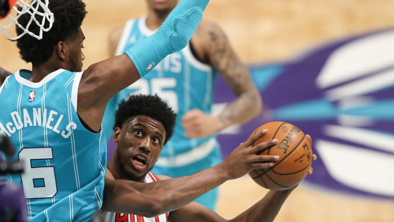 Chicago Bulls forward Thaddeus Young, right, shoots against Charlotte Hornets forward Jalen McDaniels during the second half of an NBA basketball game in Charlotte, N.C., Thursday, May 6, 2021. Chicago won 120-99. (AP Photo/Nell Redmond)
