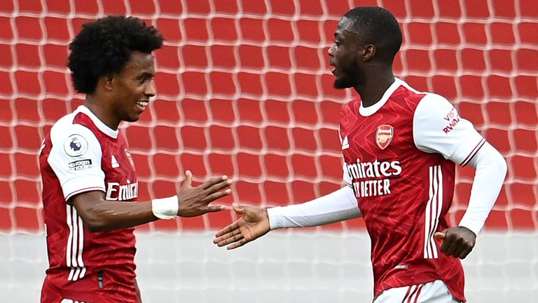 Nicolas Pepe celebrates with William after putting Arsenal 2-0 up against West Brom