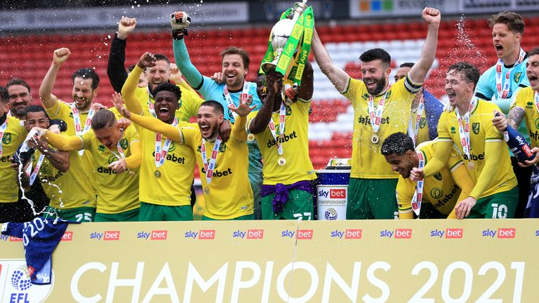 Norwich City celebrate with the trophy after the Sky Bet Championship match at Oakwell Stadium