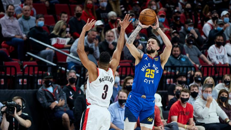 Denver Nuggets goalkeeper Austin Rivers shoots a 3-point basket at Portland Trail Blazers, CJ McCollum's goalkeeper during the first half of game 3