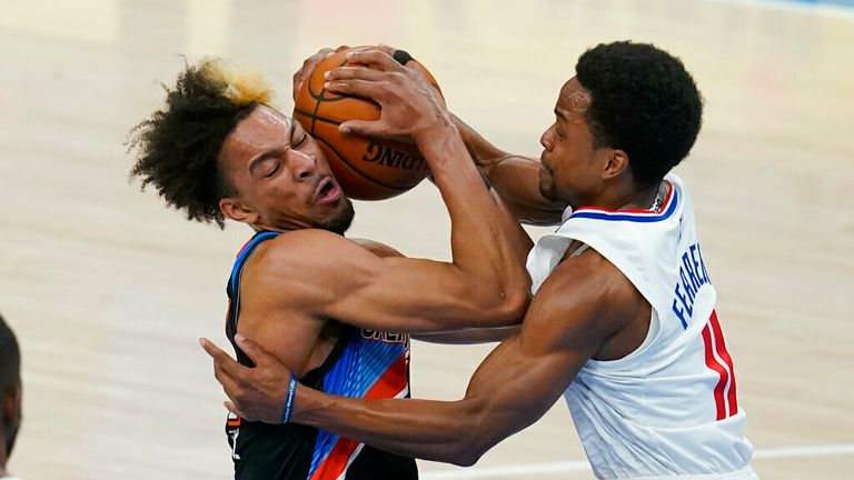 Oklahoma City Thunder forward Charlie Brown Jr., left, is fouled by Los Angeles Clippers guard Yogi Ferrell (11) in the first half of an NBA basketball game Sunday, May 16, 2021, in Oklahoma City. (AP Photo/Sue Ogrocki)