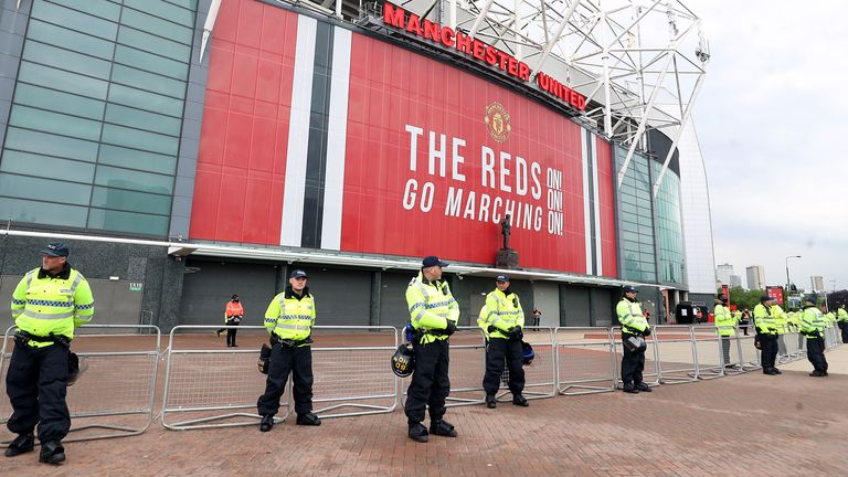 Police guard barriers outside Old Trafford ahead of the rearranged Man Utd vs Liverpool match