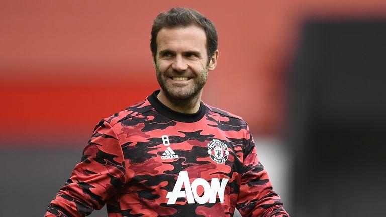 PA - Manchester United midfielder Juan Mata warms up