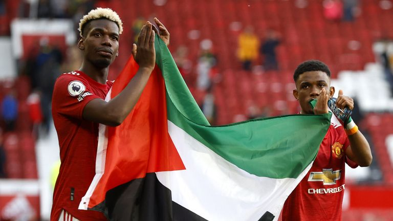 Paul Pogba and Amad Diallo held up a Palestine flag following the 1-1 draw with Fulham at Old Trafford