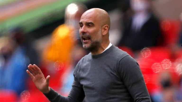 Manchester City's head coach Pep Guardiola gestures during the English League Cup final soccer match between Manchester City and Tottenham Hotspur at Wembley stadium in London, Sunday, April 25, 2021.