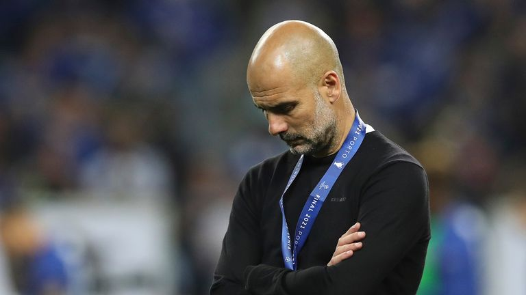 Manchester City's head coach Pep Guardiola reacts during awarding ceremony after the Champions League final soccer match between Manchester City and Chelsea at the Dragao Stadium in Porto, Portugal, Saturday, May 29, 2021