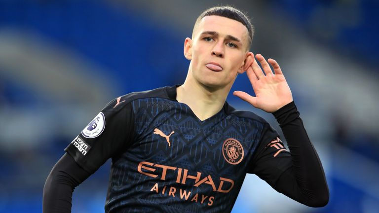 Phil Foden cups his ear in celebration